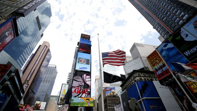 An American flag flies at half mast in Times Square In New York City on April 16, 2013. New York City and Washington, D.C are tightening security in wake of the blasts at the Boston Marathon which killed three and injured at least 176. UPI/John Angelillo