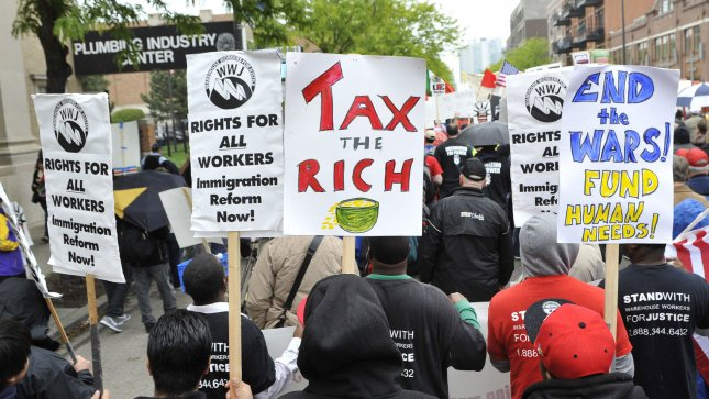 Demonstrators march through the streets on May 1, 2012 in Chicago. UPI/Brian Kersey