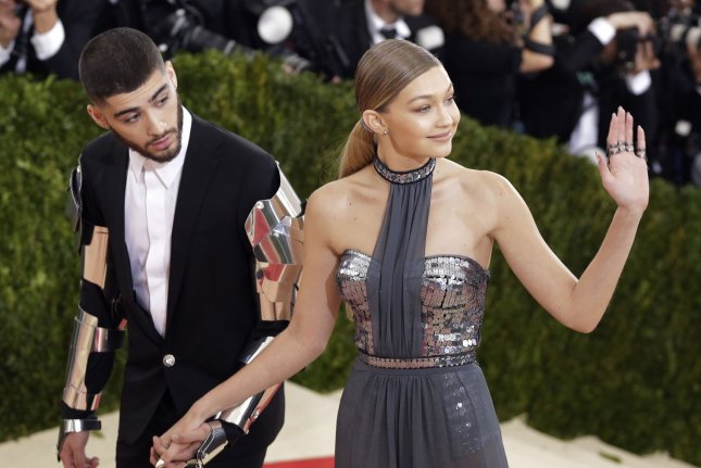 Gigi Hadid (R) and Zayn Malik at the Costume Institute Benefit at the Metropolitan Museum of Art on May 2. The model was ambushed Thursday during Milan Fashion Week. File Photo by John Angelillo/UPI
