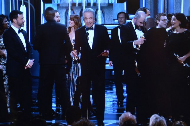 Presenter Warren Beatty explains how La La Land was announced as Best Picture only to be corrected to Moonlight, at the 89th annual Academy Awards. The accounting form PricewaterhouseCoopers will keep the high-profile gig counting Oscar ballots despite its accountant's mistake. File Photo by Jim Ruymen/UPI