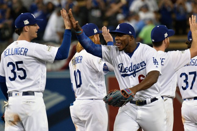 Los Angeles Dodgers right fielder Yasiel Puig (66) celebrates win over the Chicago Cubs with teammate Cody Bellinger in Game 1 of the NLCS Saturday at Dodgers Stadium in Los Angeles. Photo by Jim Ruymen/UPI