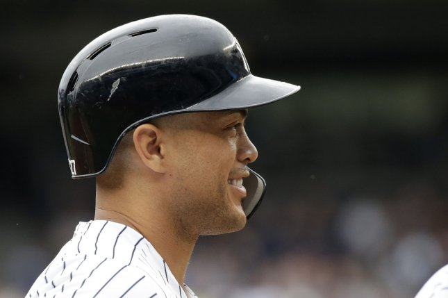 950651ce4 New York Yankees outfielder Giancarlo Stanton smiles while standing on  third base in the first inning against the Toronto Blue Jays on Sunday at  Yankee ...