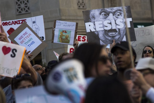 Demonstrators participate in a Not My President's Day rally near the White House to oppose President Donald Trump on President's Day, February 20, 2017. File Photo by Kevin Dietsch/UPI