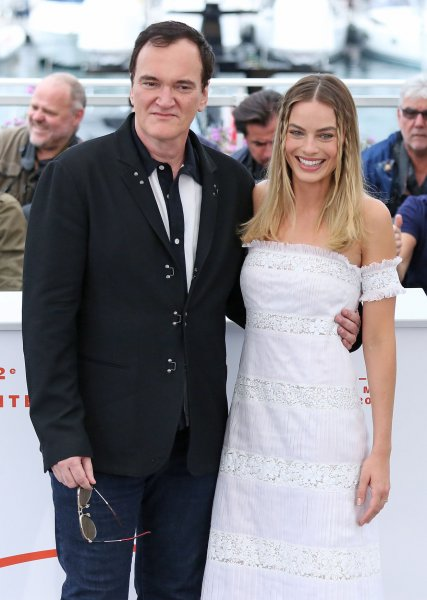 Quentin Tarantino (L) and Margot Robbie arrive at a photocall for the film Once Upon A Time In ... Hollywood during the 72nd annual Cannes International Film Festival in Cannes, France, on May 22. File Photo by David Silpa/UPI