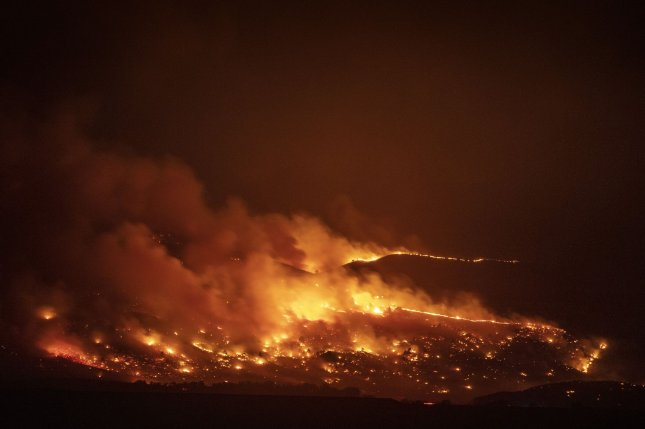 The CalWood wildfire burns in the Boulder County foothills as seen from Niwot, Colo., on Saturday. Photo by Bob Strong/UPI
