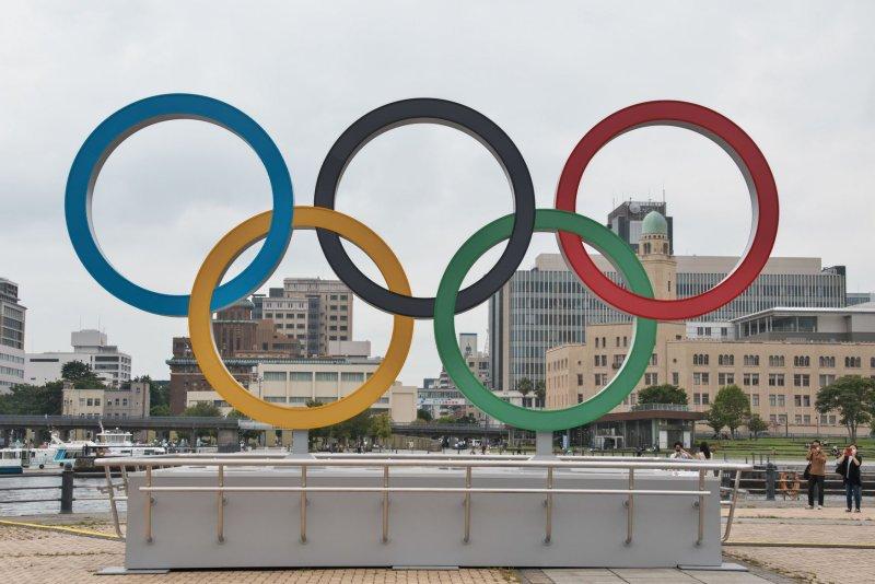 The Olympic rings are seen at Yokohama Red Brick Warehouse park in Yokohama, Japan, on June 30. File Photo by Keizo Mori/UPI