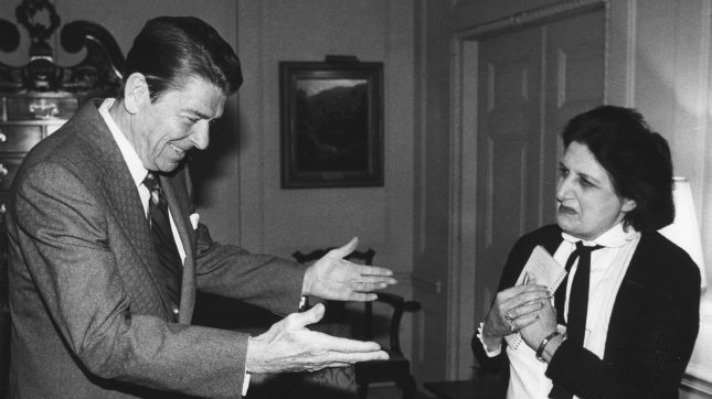 President Ronald Reagan greets United Press International (UPI) White House reporter Helen Thomas on April 22, 1981 in the Treaty Room at the White House in Washington. Reagan granted an interview with the wire services and described the March 30 attempt on his life. Thomas died Saturday at age 92. (UPI Photo/Don Rypka/Files)