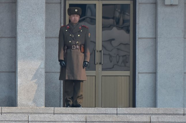 A North Korean soldier stands watching the South side at the Joint Security Area of Panmunjom in the demilitarized zone. North Korea has fortified border troops since Kim Jong Un assumed power in 2012, adding 200 new guard posts along the DMZ in 2015. File Photo by Keizo Mori/UPI