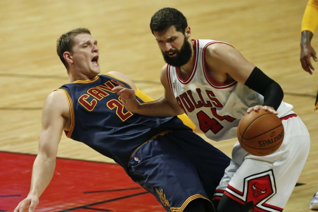 Chicago Bulls forward Nikola Mirotic (44) fouls former Cleveland Cavaliers center Timofey Mozgov (20) during the first half of their NBA game at the United Center on October 27, 2015 in Chicago. Photo by Kamil Krzaczynski/UPI