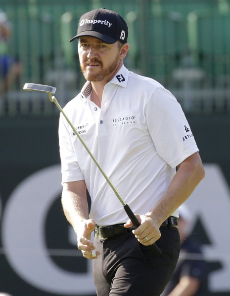 Jimmy Walker putts on the 14th green in the first round at the PGA Championship at Baltusrol Golf Club in Springfield, N.J. on THursday. He took an early lead, ending with a 65 – 5 under par. Photo by John Angelillo/UPI