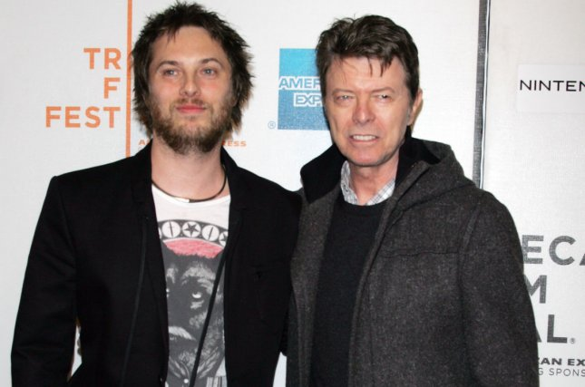 David Bowie and son Duncan Jones arrive for the Tribeca Film Festival premiere of Moon on April 30, 2009. The United Kingdom's Royal Mail launched a set of commemorative stamps featuring Bowie into space so that they could fall back to Earth. File Photo by Laura Cavanaugh/UPI
