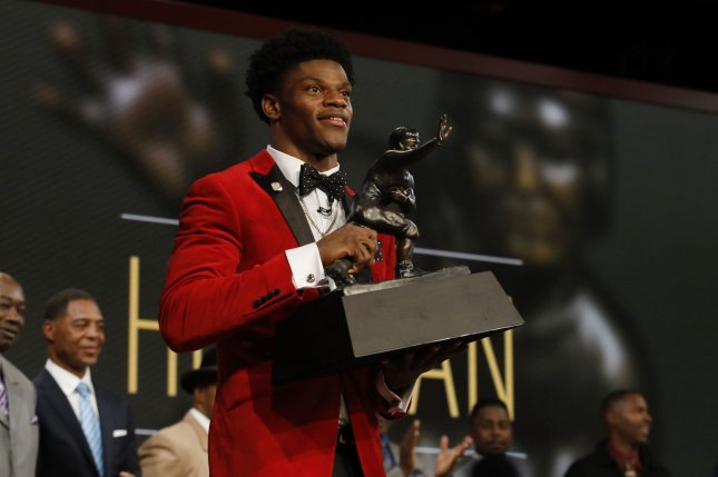 Louisville Cardinals quarterback Lamar Jackson holds the Heisman Trophy award after he wins the award in New York City on December 10, 2016. The other Heisman award finalists were Oklahoma wide receiver Dede Westbrook, Clemson quarterback Deshaun Watson, Michigan linebacker Jabrill Peppers, Oklahoma quarterback Baker Mayfield. Lamar Jackson became the youngest player and first from Louisville to win the Heisman Trophy. Pool photo by Todd J. Van Emst/Heisman Trust/UPI