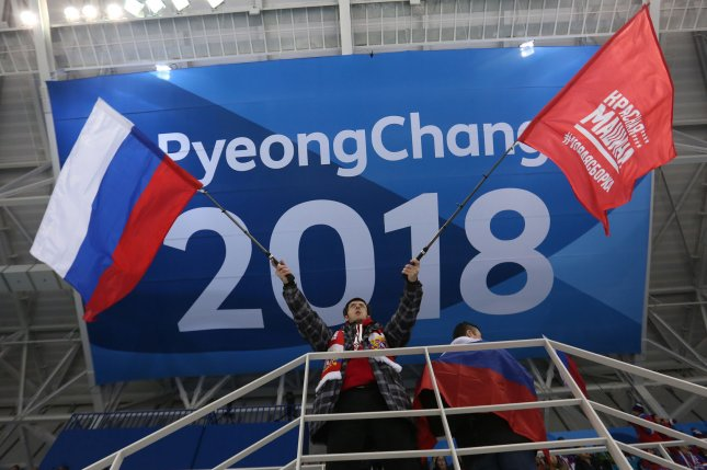 A Russian fan waves the national flag during the men's ice hockey preliminary round - group B game between Russia and USA Saturday at the Gangneung Hockey Centre in Gangneung, South Korea, during the 2018 Pyeongchang Winter Olympics. Photo by Andrew Wong/UPI
