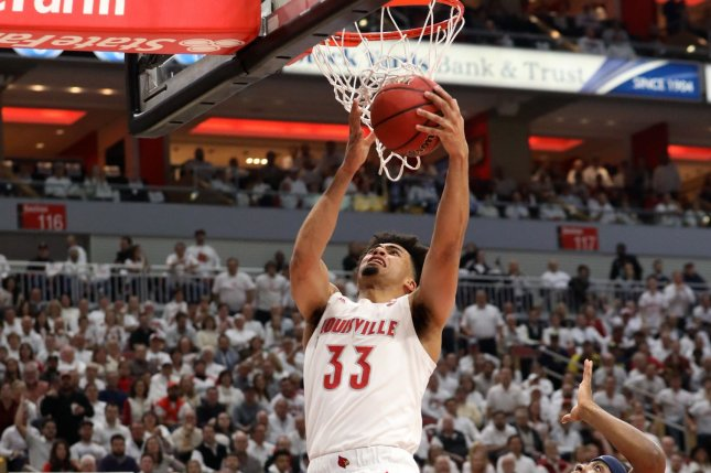 Jordan Nwora (33) scored a game-high 22 points to lead Louisville over Michigan Tuesday in Louisville, Ky. Photo by John Sommers II/UPI