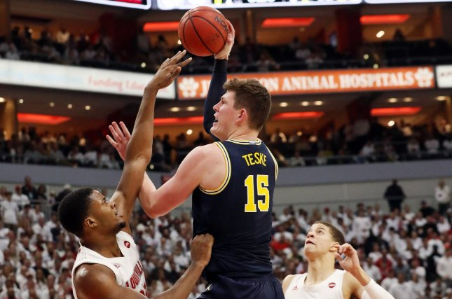 Michigan's 7-1 senior center, Jon Teske collected a double-double, as he scored 18 points and had 10 rebounds in his team's loss to Louisville.   (Photo: John Sommers II/UPI.)