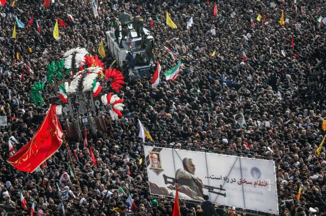 Thousands of Iranian mourners gathered around the coffins of Gen. Qassem Soleimani to pay tribute to their fallen leader during his funeral in Tehran on Monday. Photo by Majid Asgaripour/UPI