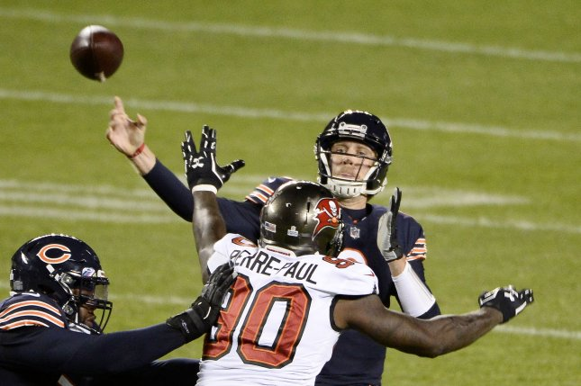 Chicago Bears quarterback Nick Foles (9) throws a 12-yard touchdown pass to tight end Jimmy Graham Thursday night amid pressure from Tampa Bay Buccaneers linebacker Jason Pierre-Paul, at Soldier Field in Chicago, Ill. Photo by Brian Kersey/UPI