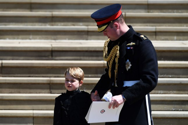 Britain's Prince William (R) and his son, Prince George, leave St. George's Chapel in Windsor Castle after the royal wedding ceremony of Prince Harry and Meghan Markle in 2018. Prince George turned eight Thursday. Pool Photo by Neil Hall/UPI