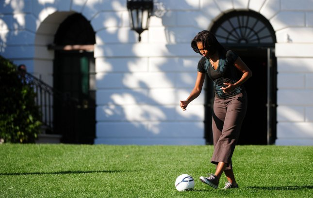 First Lady Michelle Obama plays soccer with children during a Let's Move! soccer clinic with members of the U.S. Women's Nationals Soccer Team on the South Lawn of the White House in Washington, D.C. on October 6, 2011. UPI/Kevin Dietsch