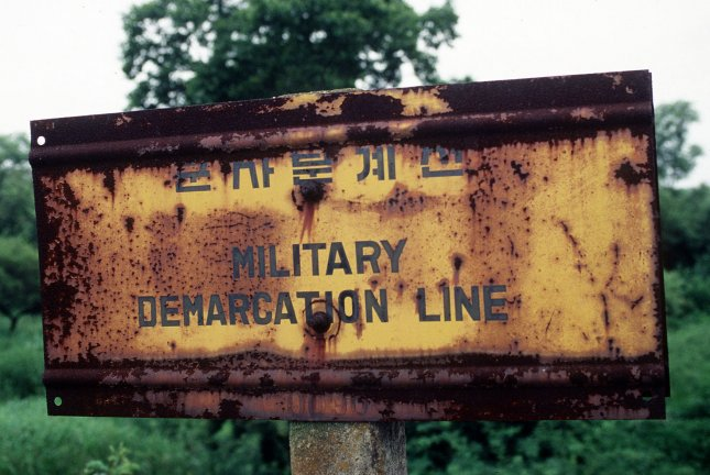 This undated Department of Defense photo shows a sign in the Demarcation Line (MDL) separating North and South Korea. (UPI Photo/Scott Stewart/USAF)