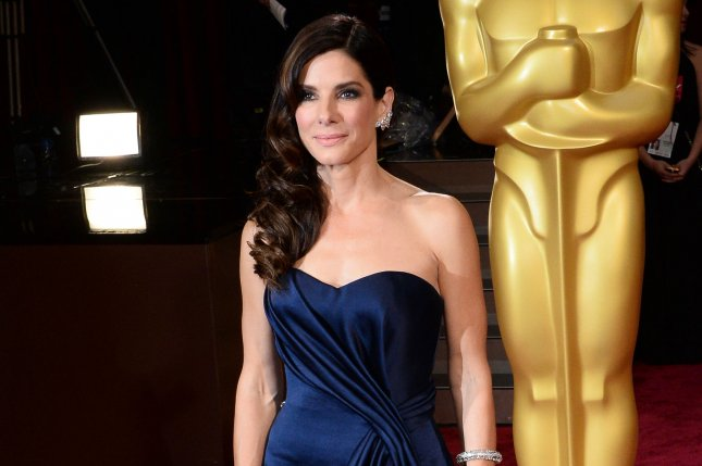 Sandra Bullock arrives on the red carpet at the 86th Academy Awards at the Hollywood and Highland Center in the Hollywood section of Los Angeles on March 2, 2014. UPI/Jim Ruymen