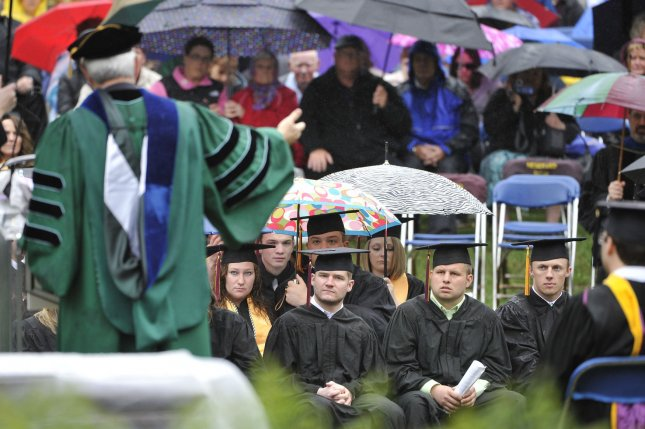 Rainy day graduates listen as Newt Gingrich delivers the keynote address at Eureka College in Illinois in 2011. But what did the future hold for them? Not a whole lot good, according to Census figures. UPI/Brian Kersey