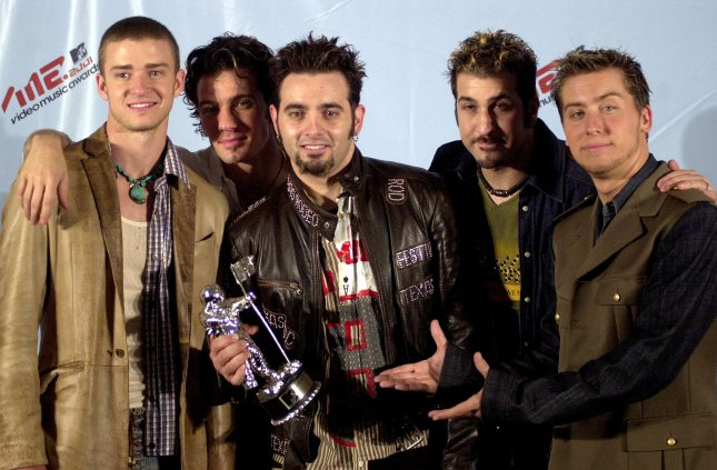 *NSYNC is reuniting for Saturday Night Live's 40th anniversary special. The boy band members are seen here at the 2001 MTV Video Music Awards. Photo by Ezio Petersen/UPI