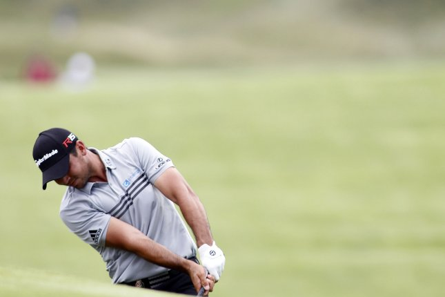 Jason Day hits his second shot onto the 10th green during the second round of the 97th PGA Championship at Whistling Straits on August 14, 2015 in Kohler, Wisconsin. Photo by Frank Polich/UPI