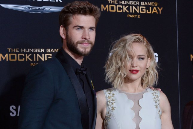 Cast members Liam Hemsworth and Jennifer Lawrence at the premiere of The Hunger Games: Mockingjay - Part 2 at the Microsoft Theater in Los Angeles on Nov. 16, 2015. Photo by Jim Ruymen/UPI