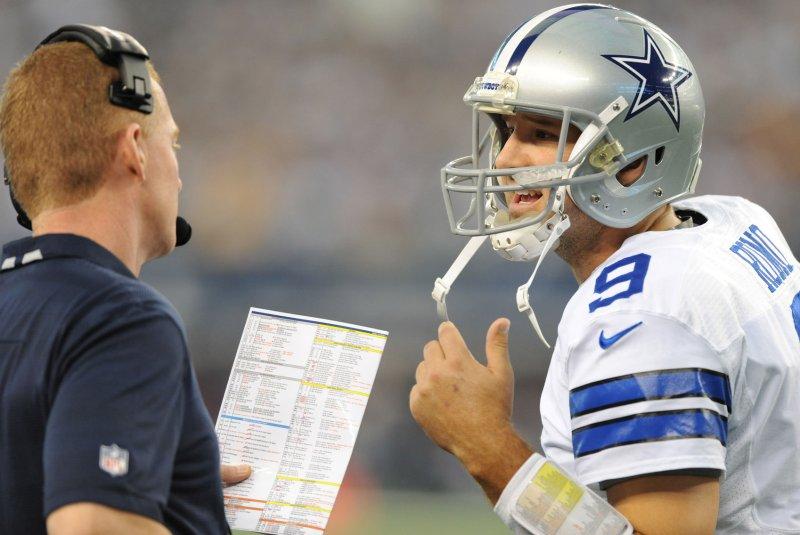 Dallas Cowboys head coach Jason Garrett and quarterback Tony Romo discuss plays during a timeout against Green Bay Packers at AT&T Stadium in Arlington, Texas on December 15, 2013. UPI/Ian Halperin