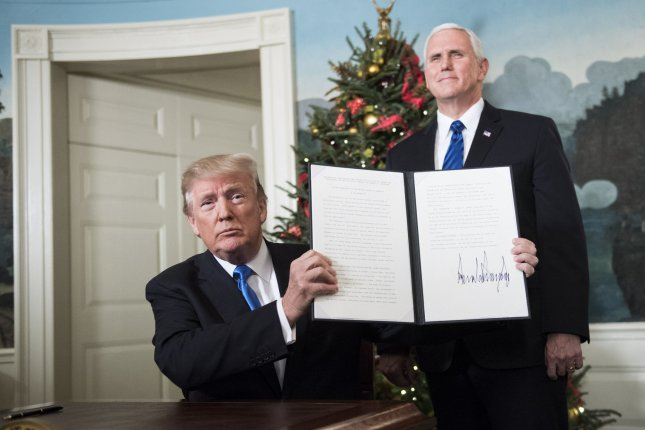 President Donald Trump holds up a proclamation after announcing that the United States will recognize Jerusalem as the capital of Israel and will eventually move its embassy there. Photo by Kevin Dietsch/UPI