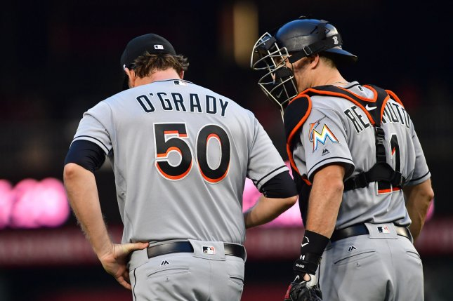 Catcher jt realmuto requests trade from miami marlins after miami marlins starting pitcher chris ogrady 50 talks to catcher jt realmuto right prior to being taken out in the second inning against the malvernweather Images