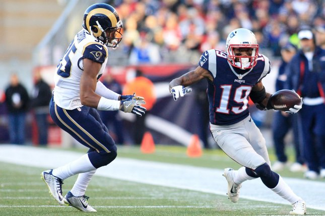 Former New England Patriots wide receiver Malcolm Mitchell (19) avoids a tackle by Los Angeles Rams cornerback Michael Jordan (35) on an 11-yard reception in the third quarter on December 4, 2016 at Gillette Stadium in Foxborough, Massachusetts. File photo by Matthew Healey/UPI