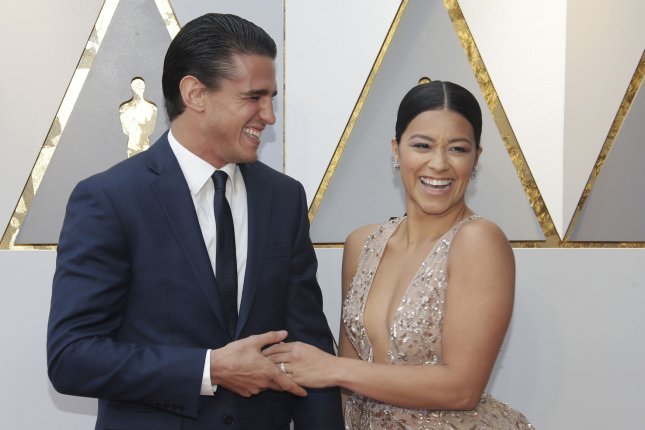 Gina Rodriguez (R), pictured with Joe LoCicero, confirmed her engagement to the actor Tuesday. File Photo by John Angelillo/UPI