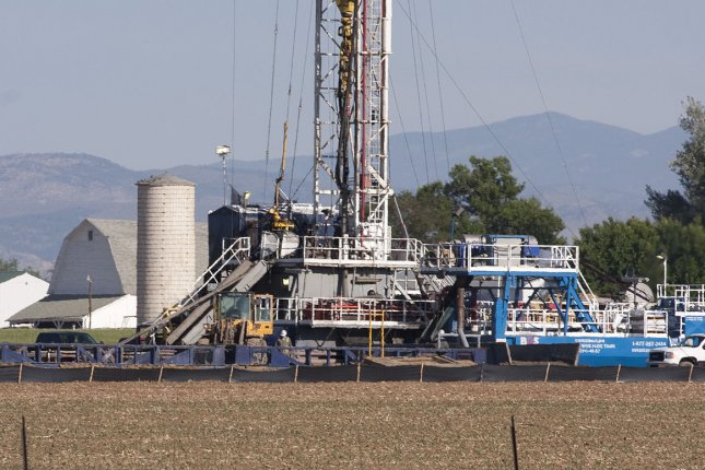 A fracking site operates at the Niobrara oil shale formation in Weld County, Colo. A report Wednesday said the U.S. shale oil industry faces prolonged industry depression caused by the coronavirus pandemic. File Photo by Gary C. Caskey/UPI