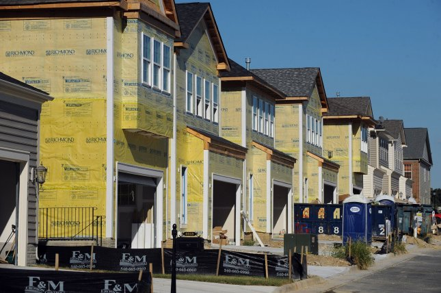 A row of new homes is seen under construction in Fairfax, Va. Wednesday's report said although low rates have caused a frenzy of refinance applications, there hasn't been a corresponding rise in first-time homebuyer applications. File Photo by Roger L. Wollenberg/UPI