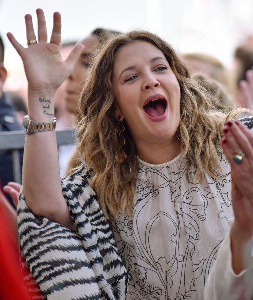 Drew Barrymore cheers for Lucy Liu during a ceremony honoring Liu with the 2,662nd star on the Hollywood Walk of Fame in Los Angeles on May 1, 2019. The actor turns 46 on February 22. File Photo by Chris Chew/UPI