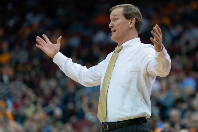 Oregon men's basketball coach Dana Altman and the Ducks automatically advance to the second round following the cancellation. File Photo by Bryan Woolston/UPI
