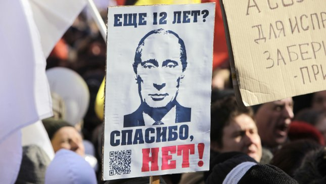 Thousands of people rally to protest against Vladimir Putin's victory in the presidential election, in Moscow on March 10, 2012. The sign reads Twelve More Years? No Thanks!. UPI/Yuri Gripas
