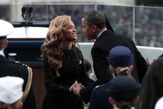 U.S. President Barack Obama greets singer Beyonce after she performs the National Anthem during the public ceremonial inauguration on the West Front of the U.S. Capitol January 21, 2013 in Washington, DC President Obama was joined by First Lady Michelle Obama and daughters Sasha and Malia. (UP/IWin McNamee/pool)