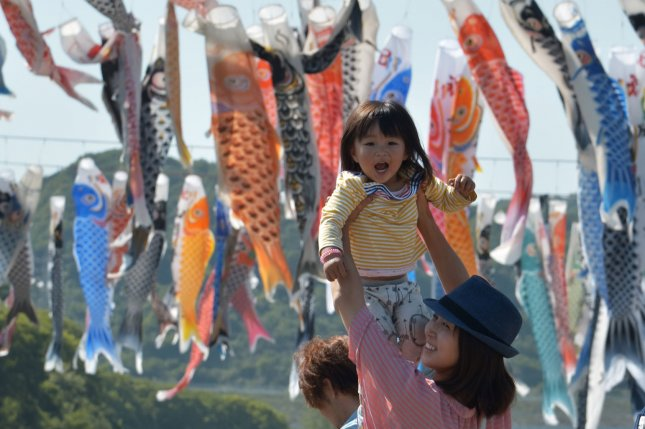 Japan estimates the population as a whole will drop to 86.7 million by 2060 with 40 percent people who are older than 65. In the picture, a girl plays under hundreds of Carp Streamers near Sagami River, Kanagawa Prefecture, Japan on May 5, 2015 during Japan's Children's Day event. Photo by Keizo Mori/UPI