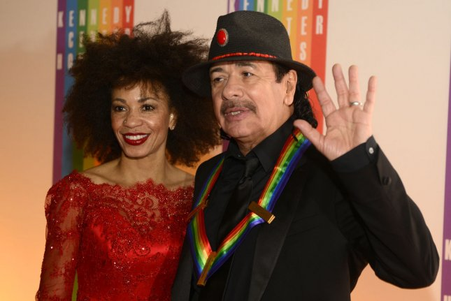 Carlos Santana (R) with wife Cindy Blackman. File photo by Mike Theiler/UPI