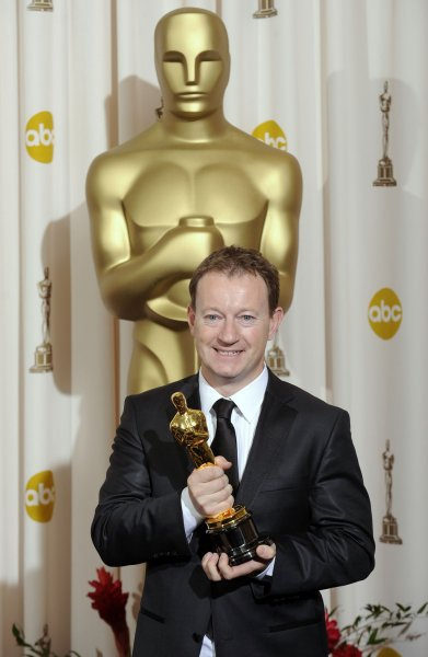 Simon Beaufoy stands with his Oscar for best adapted screenplay Slumdog Millionaire at the 81st Academy Awards in Hollywood on February 22, 2009. He is penning a television version of The Spy Who Came in From the Cold. File Photo by Phil McCarten/UPI