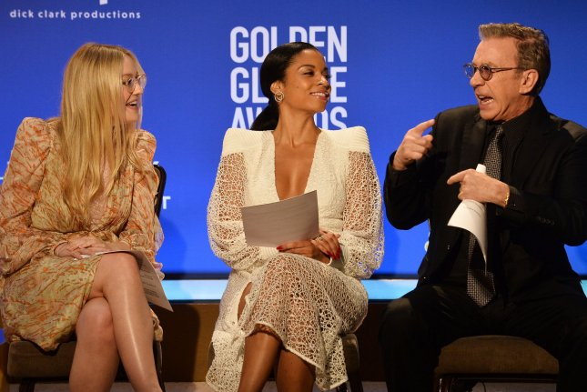 From left to right, actors Dakota Fanning, Susan Kelechi Watson and Tim Allen prepare to announce the nominees for the 77th annual Golden Globe Awards at the Beverly Hilton Hotel on Monday. Photo by Jim Ruymen/UPI