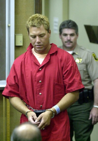 Scott Peterson is led into the Stanislaus County Superior Court on April 21, 2003, for his arraignment for the murder of his wife Laci Peterson and their unborn son. The country district attorney said she won't seek the death penalty after the state supreme court overturned his sentence. File Photo courtesy of the Modesto Bee