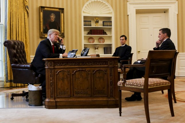 U.S. President Donald Trump speaks with the King of Saudi Arabia in the Oval Office of the White House surrounded by senior adviser Jared Kushner (C) and former national security adviser Michael Flynn on January 29. Kushner and Flynn met with Russian Ambassador to the United States Sergey Kislyak in December amid scrutiny over the Trump team's communications with Russian officials. File Pool Photo by Aude Guerrucci/UPI