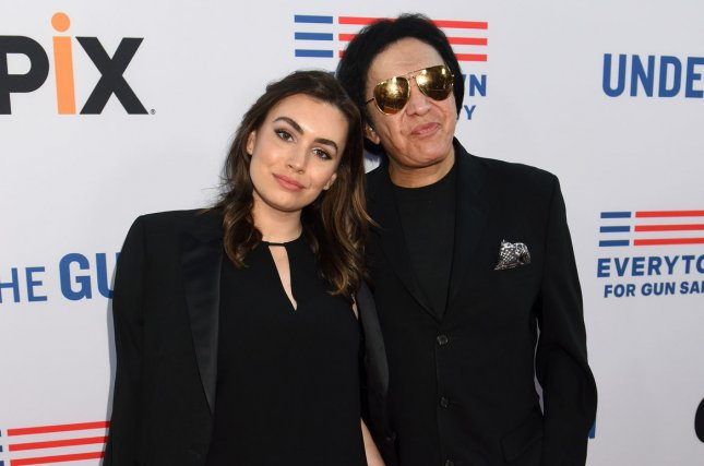 Sophie Simmons (L) and dad Gene Simmons at the Los Angeles premiere of Under the Gun on May 3, 2016. The aspiring singer said this week that Katey Sagal was low for writing about a fling with her dad. File Photo by Michael Owen Baker/UPI