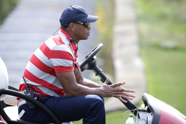 Assistant captain Tiger Woods of the United States sits in a golf cart at a practice round 2 days before the start of the Presidents Cup on September 26, 2017 at Liberty National Golf Club in Jersey City, New Jersey. Photo by John Angelillo/UPI