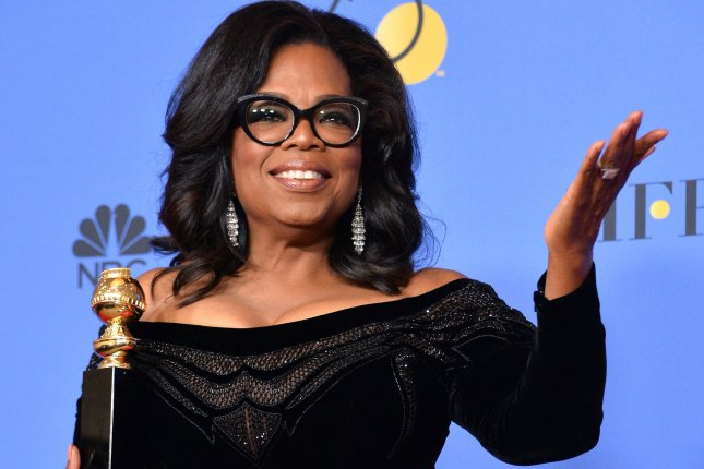 Oprah Winfrey, recipient of the Cecil B. DeMille Award, appears backstage during the Golden Globe Awards Sunday. Photo by Jim Ruymen/UPI
