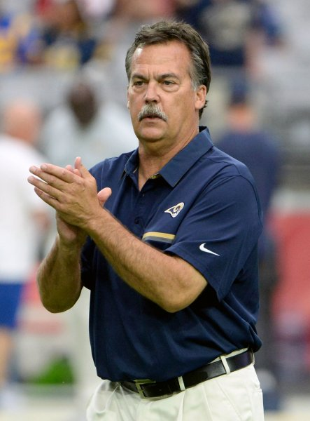 Former Los Angeles Rams head coach Jeff Fisher claps as his team warms up before a game against the Arizona Cardinals in 2016. Photo by Art Foxall/UPI